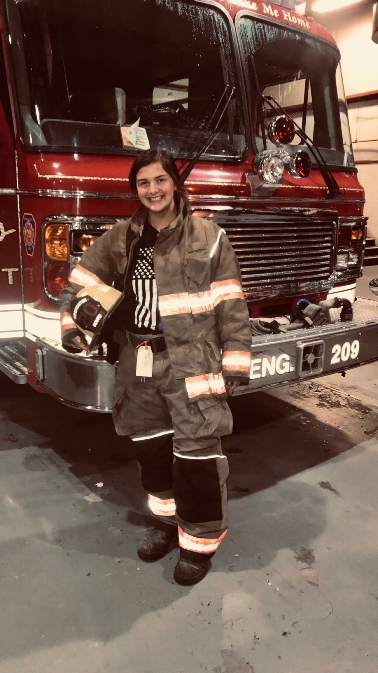 Abigail in firefighter uniform